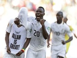 Ghana's Mubarak Wakaso (hidden) is congratulated on his goal against Mali by Kwadwo Asamoah on January 24, 2013