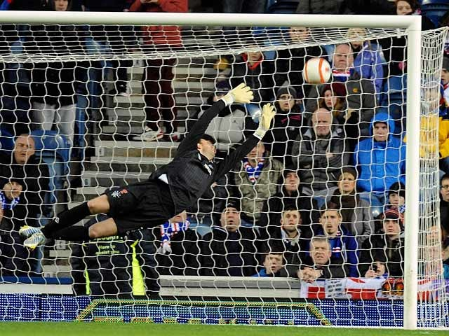 Rangers' keeper Neil Alexander fails to stop Montrose David Gray's long-range strikes to equalise in their league match on January 26, 2013