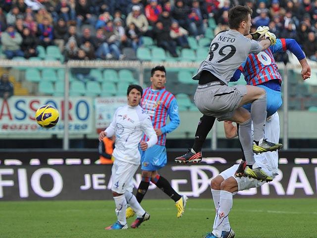Catania's Nicola Legrottaglie scores the equaliser against Fiorentina on January 27, 2013