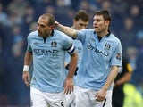 James Milner congratuates Pablo Zabaleta on his goal against Stoke during their FA Cup fourth round tie on January 26, 2013
