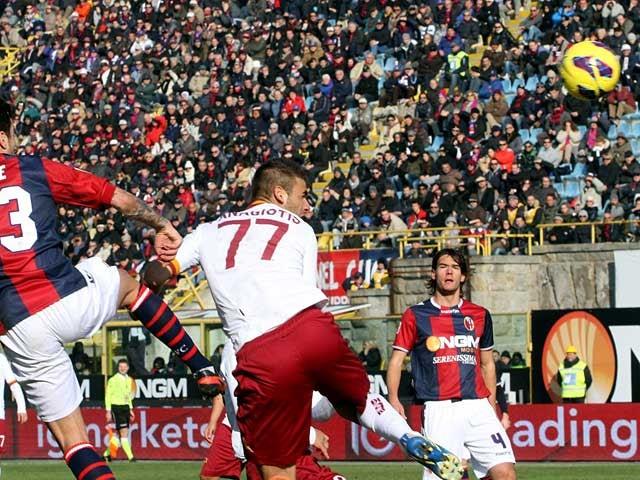 AC Roma's Panagiotis Tachtsidis heads in the equaliser against Bologna on January 27, 2013