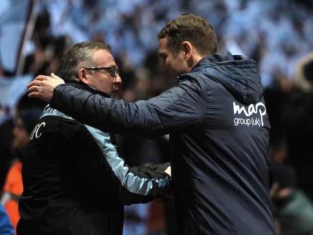 Villa boss Paul Lambert greets Bradford manager Phil Parkinson before the League Cup semi-final second leg on January 22, 2013