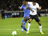 Corinthians' Paulinho tackles Ramires for the ball during the game with Chelsea on December 16, 2012