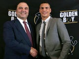 CEO of Golden Boy Promotions Richard Schaefer shakes hands with Anthony Ogogo during a press conference on January 16, 2013