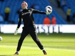 Manchester City goalkeeper Richard Wright warms up before his sides match against Sunderland on October 6, 2012