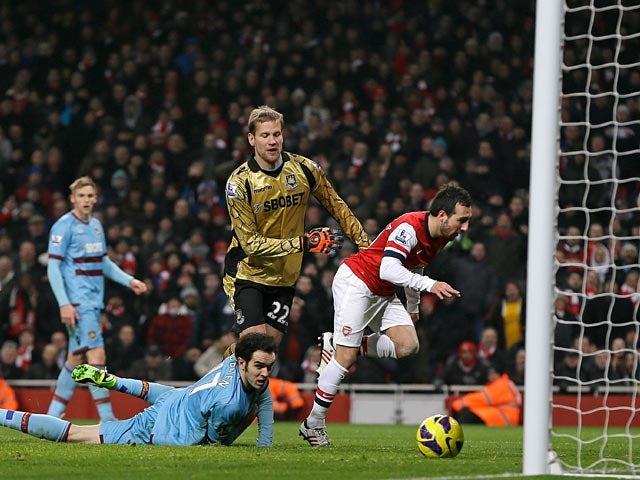 Santi Cazorla scores his team's third goal against West Ham on January 23, 2013