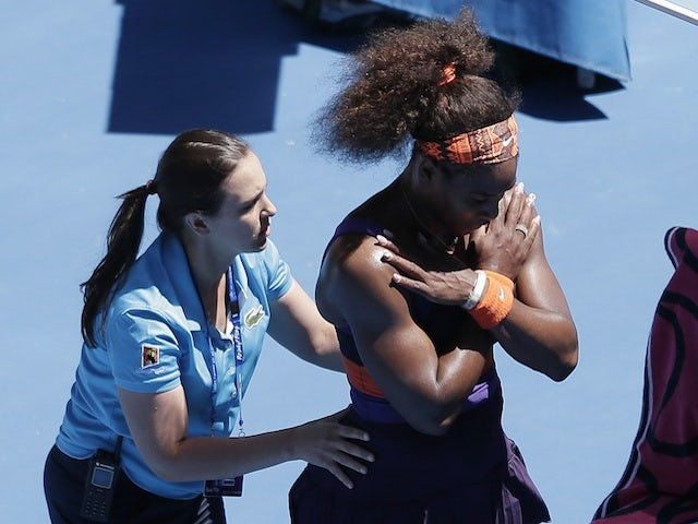 An injured Serena Williams receives treatment during her match with Sloane Stephens on January 23, 2013