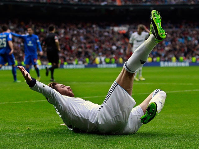 Sergio Ramos slides on the floor as he celebrates scoring the opening goal against Getafe on January 27, 2013