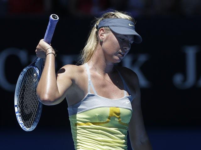 Maria Sharapova reacts during her semifinal loss to Li Na at the Australian Open tennis championship on January 24, 2013