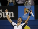 Novak Djokovic celebrates defeating Tomas Berdych at the Australian Open tennis championship on January 22, 2013