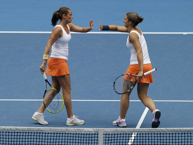Italians Sara Errani (right) and Roberta Vinci (left) during the their women's doubles final in the Australian Open tennis championship on January 25, 2013