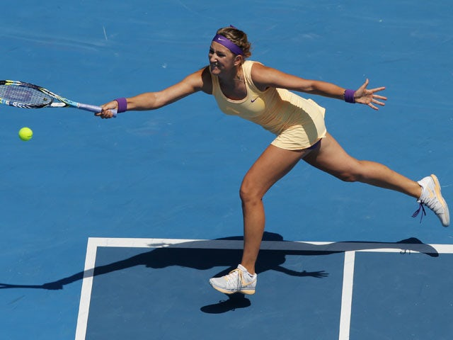 Victoria Azarenka from Belarus stretches for the ball in her fourth round match at the Australian Open tennis championship on January 21, 2013