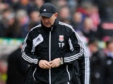Stoke City manager Tony Pulis looks at the ground moments after the final whistle as his team loses to Manchester City in the FA Cup fourth round on January 26, 2013