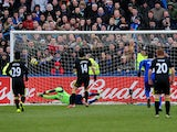 Wigan Athletics's Jordi Gomez scores from the penalty spot in his sides match with Macclesfield on January 26, 2013