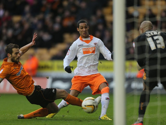 Blackpool player Thomas Ince scores for his side in their Championship match with Wolverhampton Wanderers on January 26, 2013