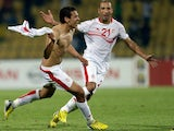 Tunisia's Youssef M'sakni celebrates his winner against Algeria on January 22, 2013