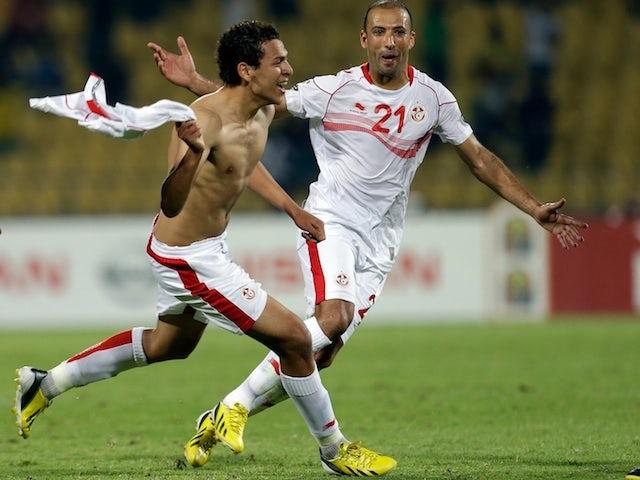 Tunisia's Youssef M'sakni celebrates his winner against Algeria on January 22, 2013
