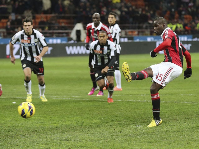 New AC Milan signing Mario Balotelli scores a penalty in the last minute of his side's game with Udinese on February 3, 2013
