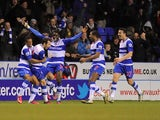 Reading's Adam Le Fondre celebrates with teammates after a stoppage time equaliser against Chelsea on January 30, 2013