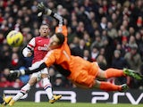 Alex Oxlade-Chamberlain has an effort well saved by Asmir Begovic of Stoke on February 2, 2013