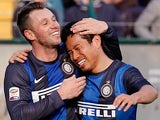 Inter's Antonio Cassano is congratulated by team mate Yuto Nagatomo after scoring the equaliser against Siena on Febraury 3, 2013