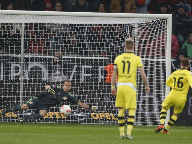 Dortmund player Jakub Blaszczykowski scores from the penalty spot in his team's game with Bayer Leverkusen on February 3, 2013