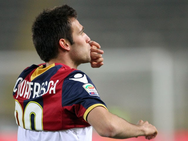 Bologna player Robert Acquafresca celebrates after scroing for Bologna on March 4, 2012