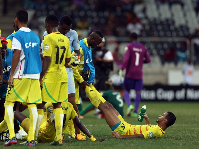 Togo's Alaixys Romao receives treatment during extra time in his side's African Cup of Nations quarter final match on February 3, 2013