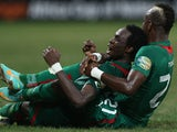 Burkina Faso player Jonathan Pitroipa celebrates with a teammate after scoring an extra time goal against Togo in the African Cup of Nations quarter final on February 3, 2013