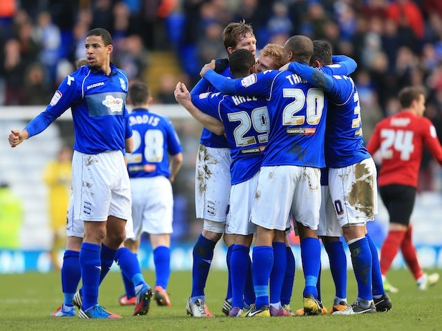Birmingham players surround Chris Burke following his goal against Forest on February 2, 2013