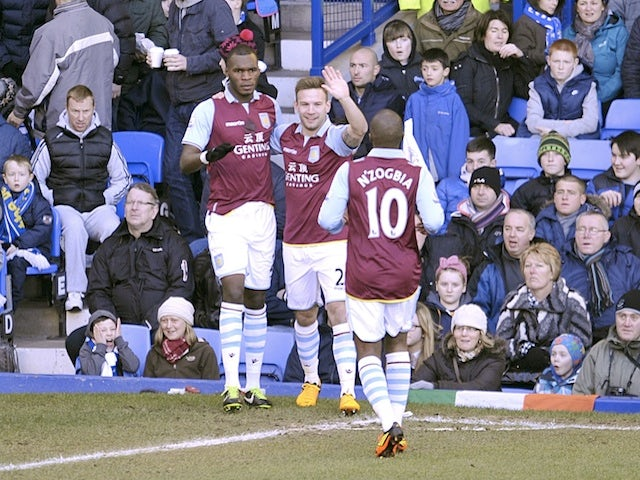 Villa's Christian Benteke is congratulated by teammates after opening the scoring against Everton on February 2, 2013