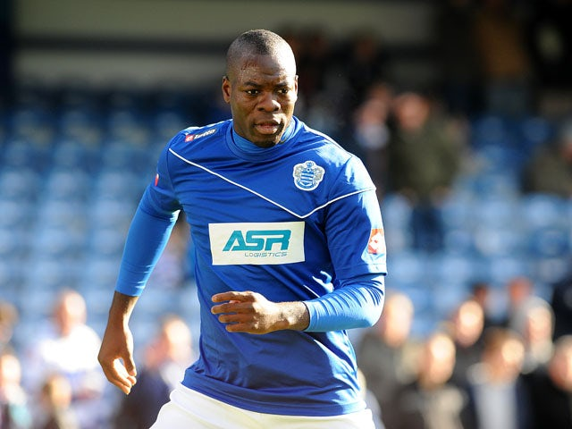 New QPR signing Christopher Samba prior to kick off in his side's match with Norwich on February 2, 2013