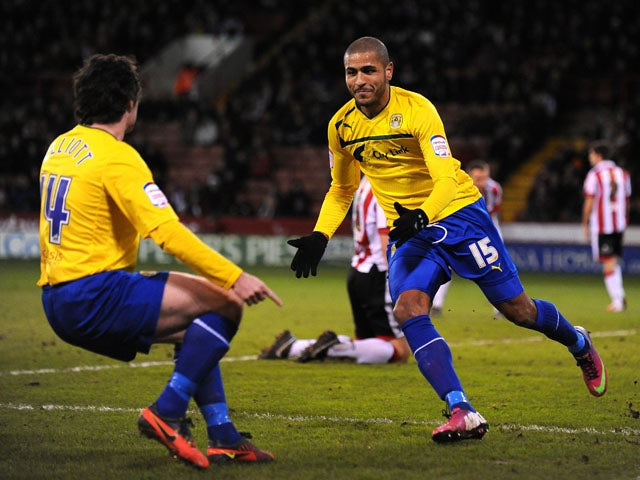 Coventry City player Leon Clarke celebrates with a teammate after scoring his sides opening goal in their match with Sheffield United on February 1, 2013