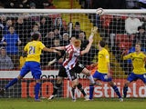 Sheffield United's Dave Kitson heads the equalising goal in his team's game with Coventry City on February 1, 2013