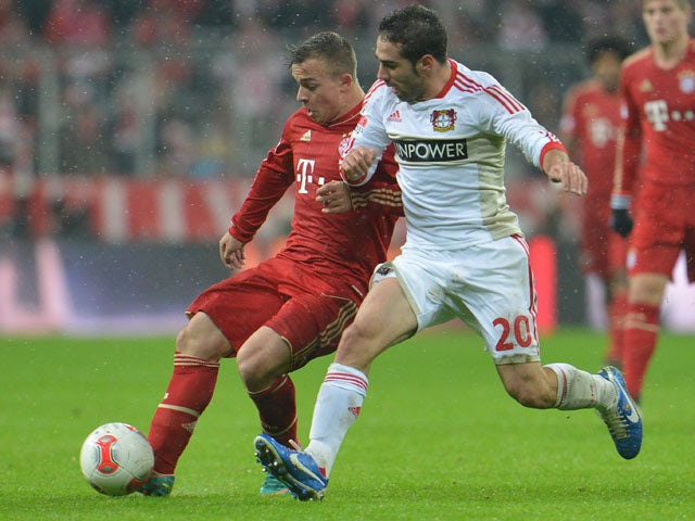 Bayer Leverkusen player Daniel Carvajal (right) challenges for the ball with Bayern Munich player Xherdan Shaqiri during their sides match on October 28, 2012