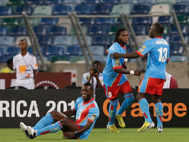 Congo's Dieumerci Mbokani celebrates with team mate Alain Kaluyituka after scoring the opening goal in the Africa Cup of Nations against Mali on January 28, 2013