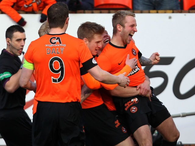 Johnny Russell celebrates with his Dundee United teammates after scoring the first goal in their match against Rangers on February 2, 2013