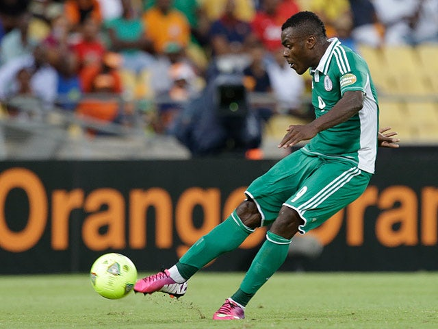 Nigeria's Emmanuel Emenike takes a free kick to score the opening goal of the match against Ivory Coast on February 3, 2013
