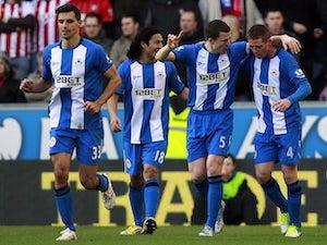 Half-Time Report: Caldwell heads Wigan ahead