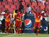 Ghana players celebrates after scoring against Niger on January 28, 2013