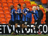 Barnsley's Jason Scotland is congratulated by teammates after a goal against Blackpool on February 2, 2013