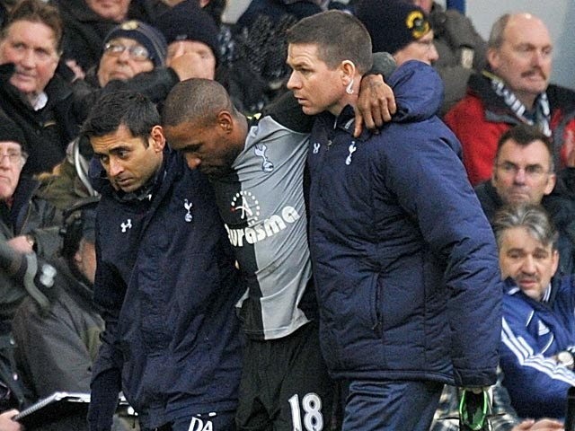 Jermain Defoe is helped by his team's physio's after picking up an ankle inury during the match against West Brom on February 3, 2013