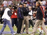 Brother and opposing coaches John & Jim Harbaugh on the field before Superbowl XLVII on February 3, 2013