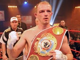 German Juergen Braehmer celebrates after winning the WBO World Championship Light Heavyweight title on December 18, 2009