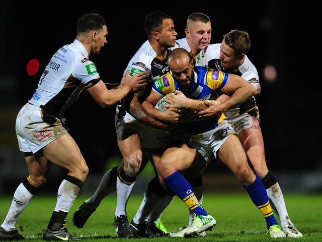Leeds Rhinos' Jamie Jones-Buchanan is held by the Hull FC defence in the Super League match on February 1, 2013