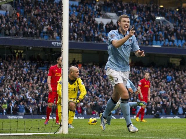 Manchester City forward Edin Dzeko celebrates after scoring against Liverpool on February 3, 2013
