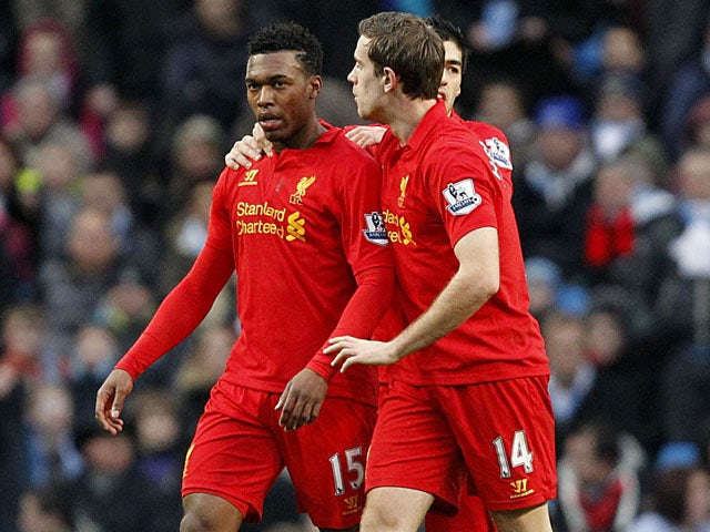 Liverpool striker Daniel Sturridge is congratulated by teammates after scoring against Manchester City on February 3, 2013