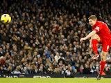 Liverpool captain Steven Gerrard scores his side's second goal against Manchester City on February 3, 2013