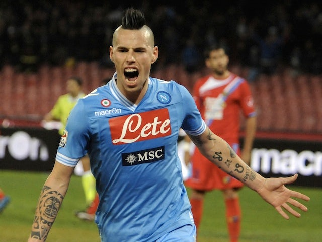 Napoli's Marek Hamsik celebrates a goal against Catania on February 2, 2013