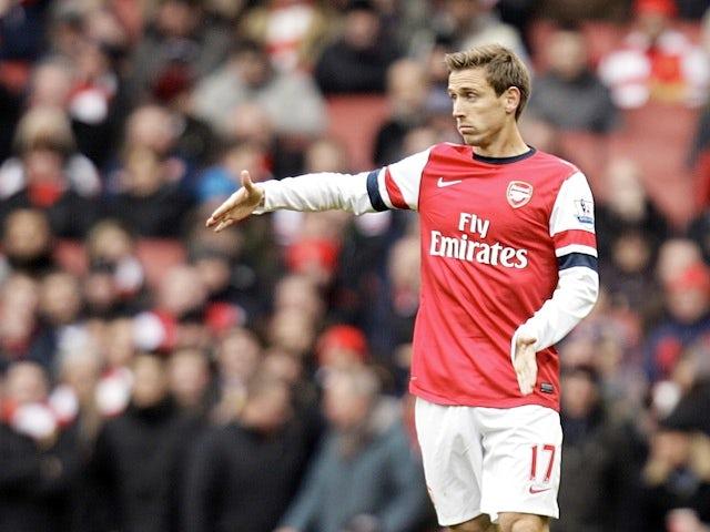 Result: Podolski gives Arsenal win over Stoke